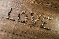 Amour écrit avec des pierres Images libres de droits
