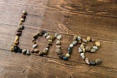 Amour écrit avec des pierres Image libre de droits