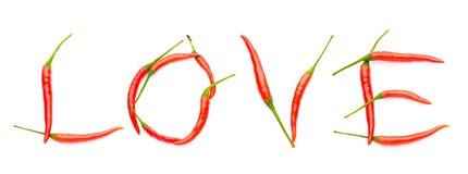 Amour écrit avec des poivrons de piment Photographie stock libre de droits
