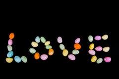 Amour écrit avec la sucrerie Image stock