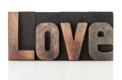 Amour écrit avec le type d'impression typographique Images libres de droits