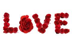 AMOUR écrit avec les roses rouges d'isolement sur le blanc Images libres de droits