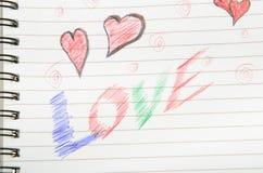 Amour écrit dans le carnet. Photo stock