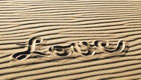 Amour écrit dans le sable ondulé, grand parc national de dunes de sable Image libre de droits