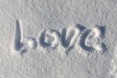 Amour écrit de neige Image libre de droits