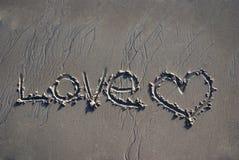 Amour écrit en sable Image libre de droits
