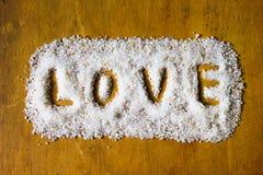 Amour écrit en sel Images libres de droits