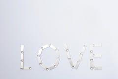 Amour écrit par des bâtons d'USB Photographie stock libre de droits
