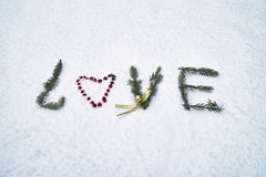 Amour écrit sur la neige Image libre de droits