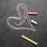 Amour écrit sur le tableau Image libre de droits