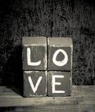 Amour affligé en bois de blocs Photo libre de droits