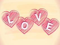 Amour aux coeurs rayés au-dessus du fond beige Images stock