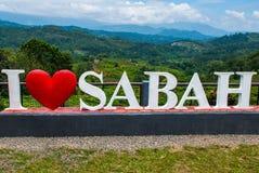 Amour blanc énorme Sabah du lettrage I Le Bornéo, Malaisie Images stock