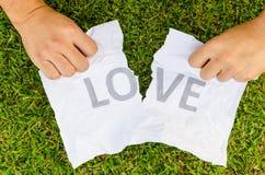 Amour cassé avec la main Photos libres de droits