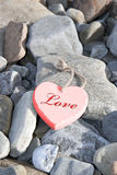 Amour chaud sur les roches Photographie stock
