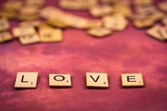 Amour - concepts en bois de lettres d'alphabet Photo stock