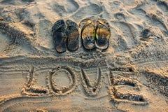 Amour d'écriture de sable Image stock