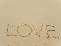 Amour d'écriture sur la plage Photo libre de droits