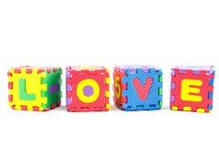 Amour d'alphabet apprenant des blocs sur le fond blanc Image stock