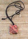Amour d'amulette d'argile Image stock
