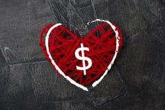 Amour d'argent Un symbole dollar sur un coeur rouge Thème d'amour Image libre de droits