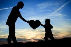Amour d'enfant de mère Photographie stock