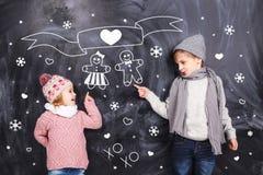 Amour d'hiver d'enfants Photo libre de droits