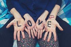 Amour d'inscription face aux couples Image stock