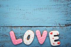 Amour d'inscription par des biscuits Photo stock