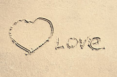 Amour d'inscription sur le sable Photo stock