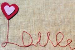 Amour d'inscription sur le tissu. Photographie stock libre de droits