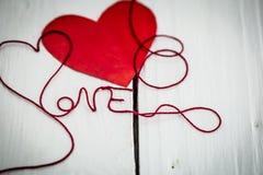 Amour d'inscription sur un fond blanc Images stock
