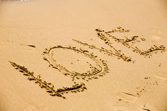 Amour d'inscription sur un sable Photos stock