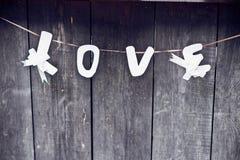 Amour d'inscription sur une corde Photos stock
