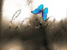 Amour d'inscription sur une fenêtre congelée d'hiver Image libre de droits