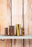 Amour dans des lettres d'impression Photographie stock