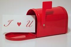 Amour dans la boîte aux lettres Photos stock
