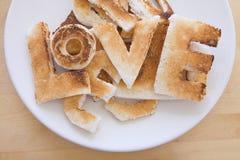 Amour dans le pain grillé Photos libres de droits