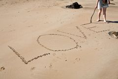 Amour dans le sable Photos stock