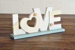 Amour dans les lettres bleues Photos stock