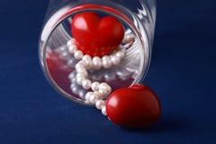 Amour dans un choc en verre Photographie stock