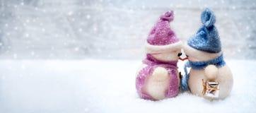 Amour de bonhommes de neige sur Noël Image stock