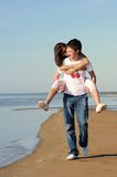 amour de couples de plage Photographie stock libre de droits