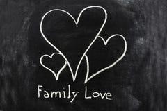 Amour de famille esquissé sur le tableau noir Photographie stock libre de droits