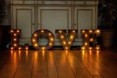 Amour de lettres avec la lumière Image stock