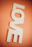 Amour de lettres sur le fond orange Image stock