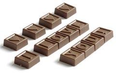Amour de mot fait de chocolats Photographie stock