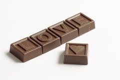 Amour de mot fait de chocolats Image stock