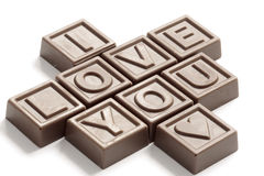 Amour de mot fait de chocolats Photos stock