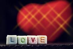 Amour de mots vous écrit dans les blocs en céramique Image stock